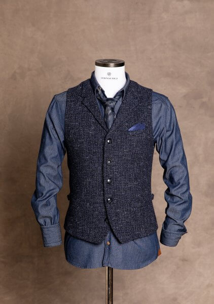 Dark blue premium men's vest gilet from DORNSCHILD with subtle blue gray pattern and collar for a classy and smart style.