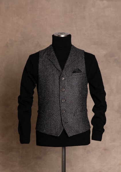 Chic, classy and casual single-breasted men's vest gilet from DORNSCHILD with collar lapel black gray patterned from the finest Italian fabric.